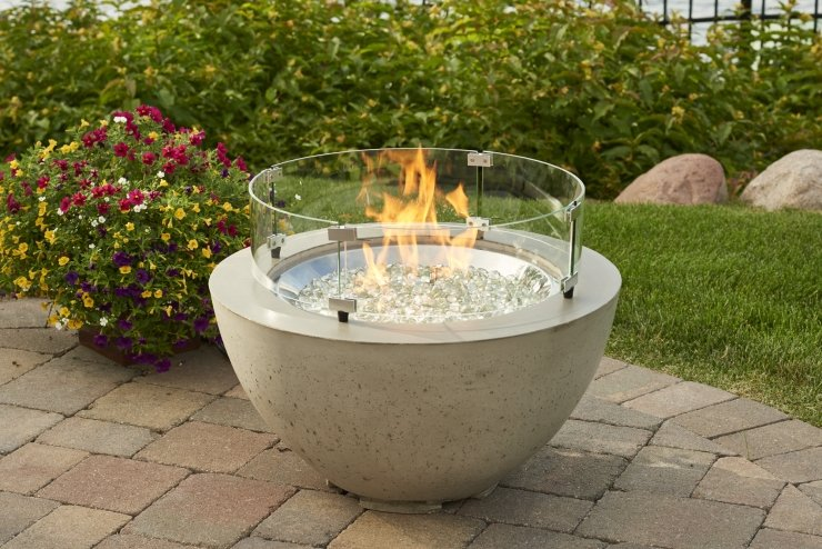 Gas fire tables in Calgary showing the Cove 20 with flames on.