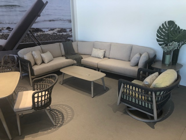 The Coconut Grove sectional with club chair and coffee table.