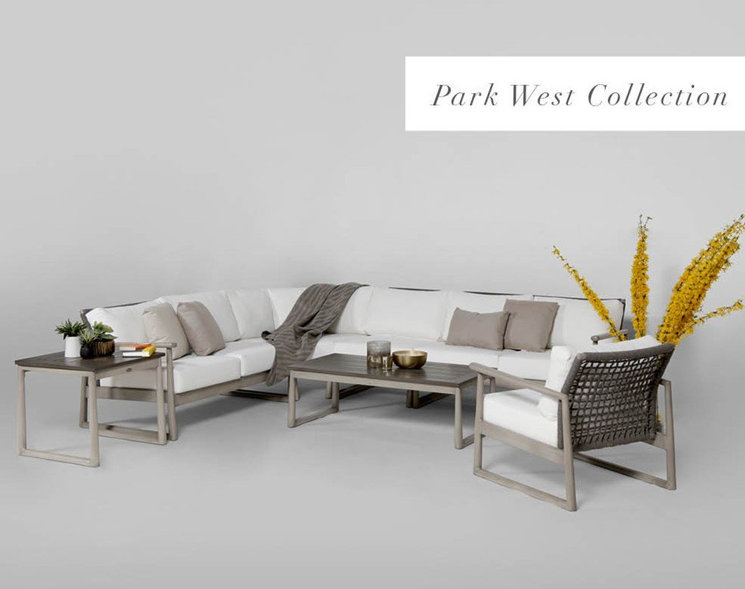 The Park West sectional Ratana, with a club chair, toss pillows, a blanket and plant in background.