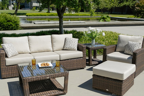 Portofino patio collection, a sofa, chair and tables outdoors.