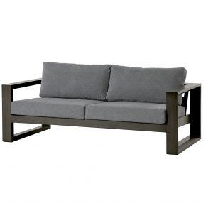 A modern looking dark grey metal frame patio sofa with grey cushions.