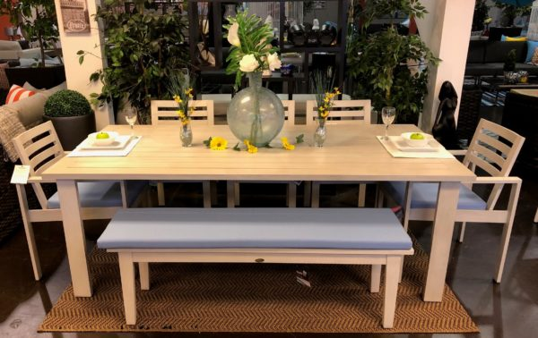 Element dining collection in white with blue cushions, showcasing the limo bench.