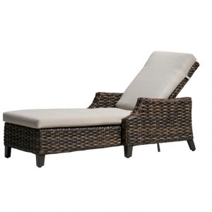 Multi toned brown wicker Whidbey Island Lounge Chair with beige colored cushion.