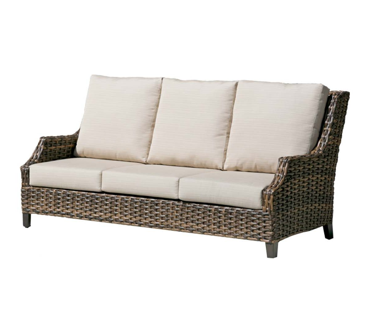 A high back Whidbey Island Sofa with tapered arms and beige colored cushions.