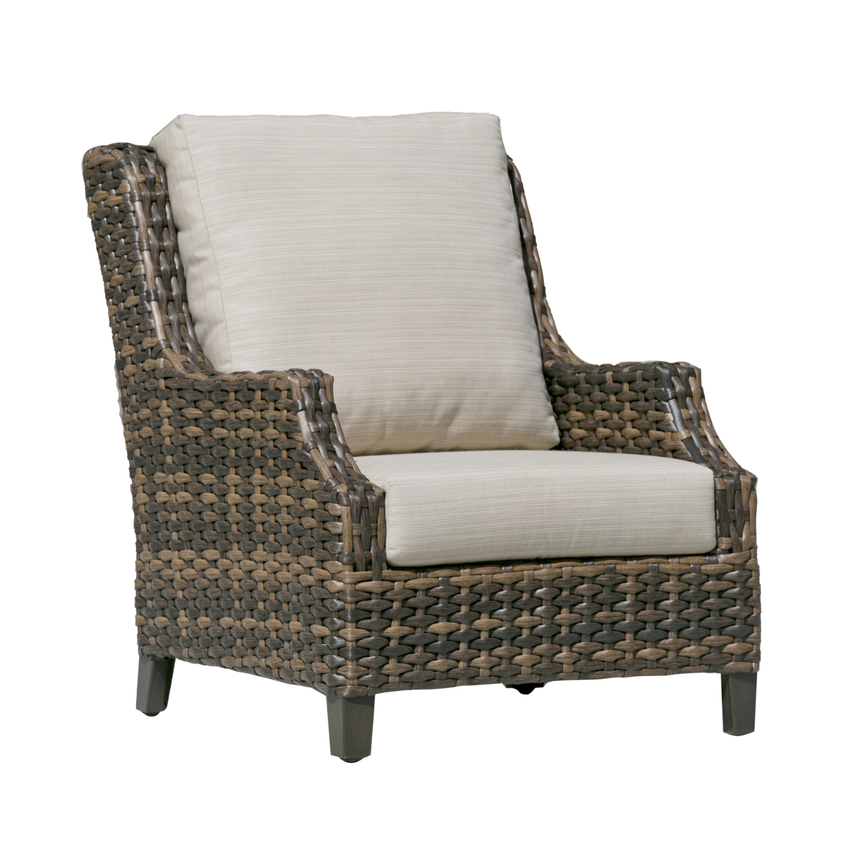 The Whidbey Island club chair with metal legs, tapered arms and beige cushions, over a multi tone brown wicker.