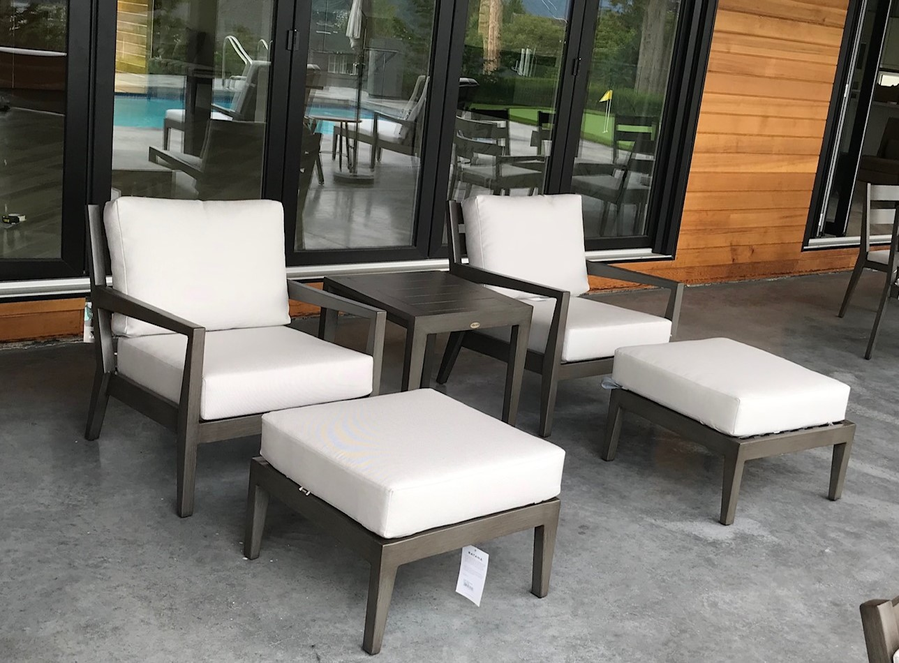 Lucia Club Chairs & ottomans showing the Lucia end table.
