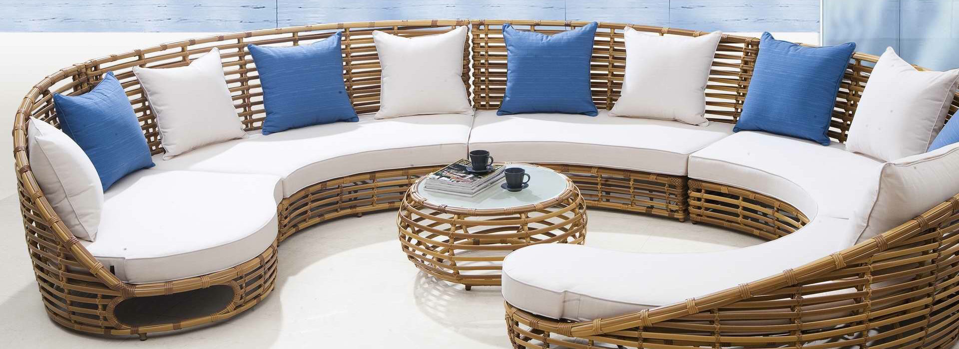 Amazing patio furniture starts with an idea, then add cream and blue toss pillows to it.