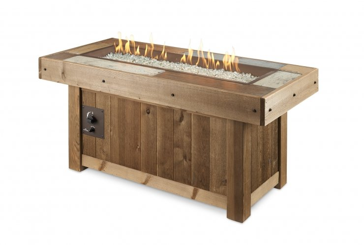 A vintage looking, distressed wood color linear fire table with flames on.
