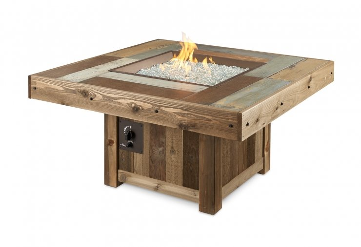 The Vintage square fire table with flames on.