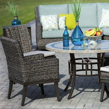 Outdoor patio chair with round marble table.
