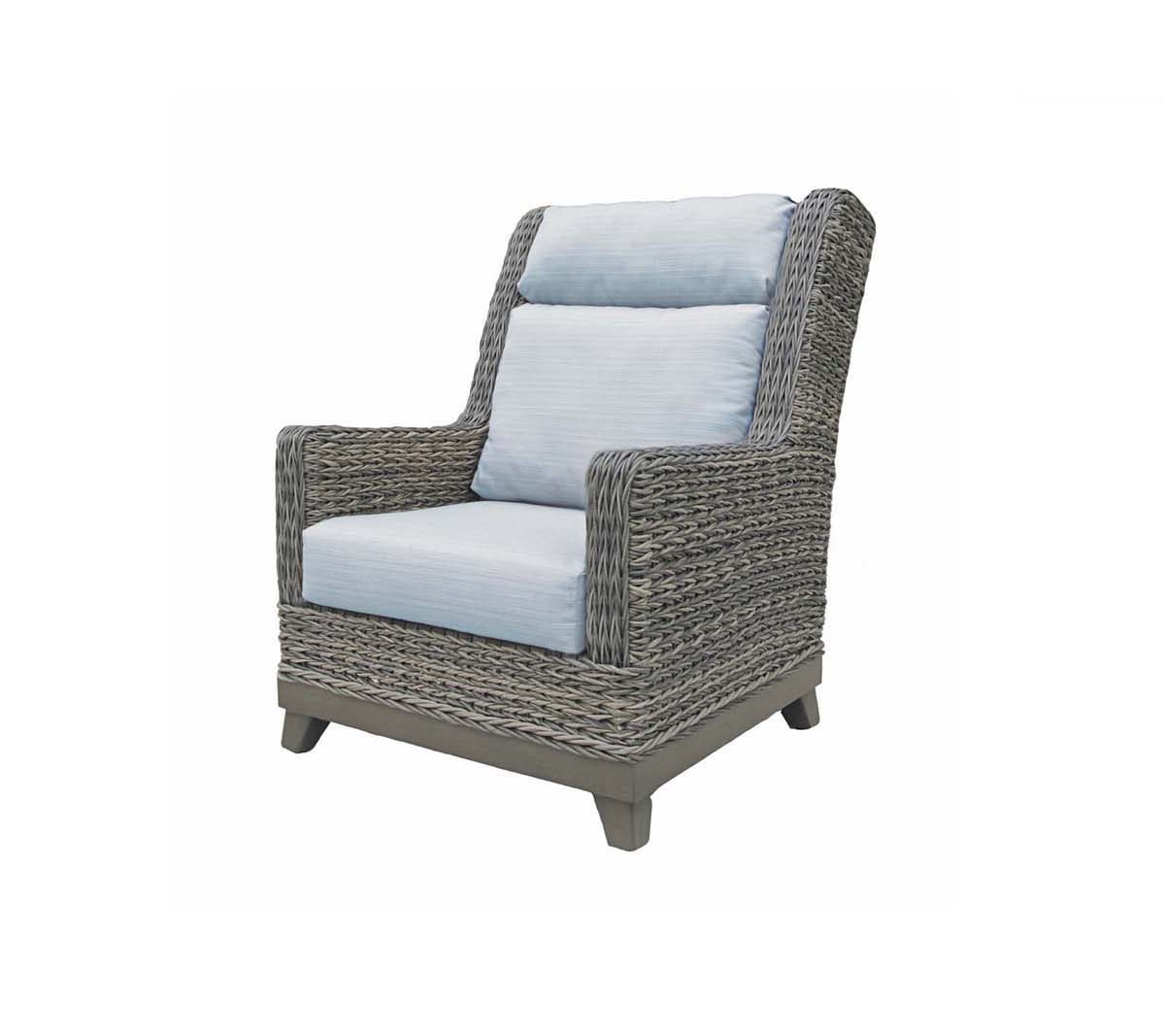 Boston highback wing chair in grey toned wicker with light blue cushions.