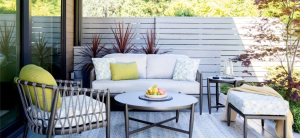 Lamego patio set in a backyard patio on a sunny day