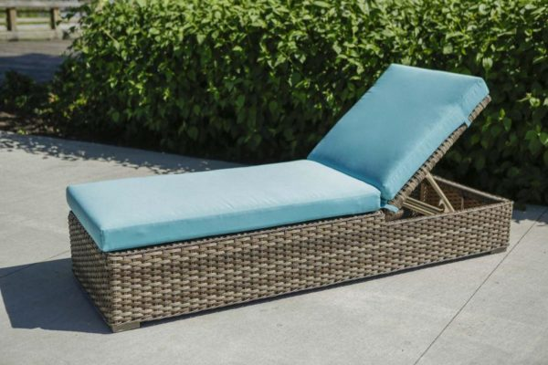 nottingham patio lounger outside on deck, with teal cushion, bushes behind it