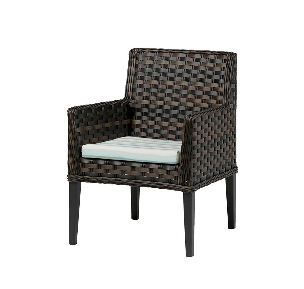 San Sebastian dining chair in brown wicker with striped seat cushion.