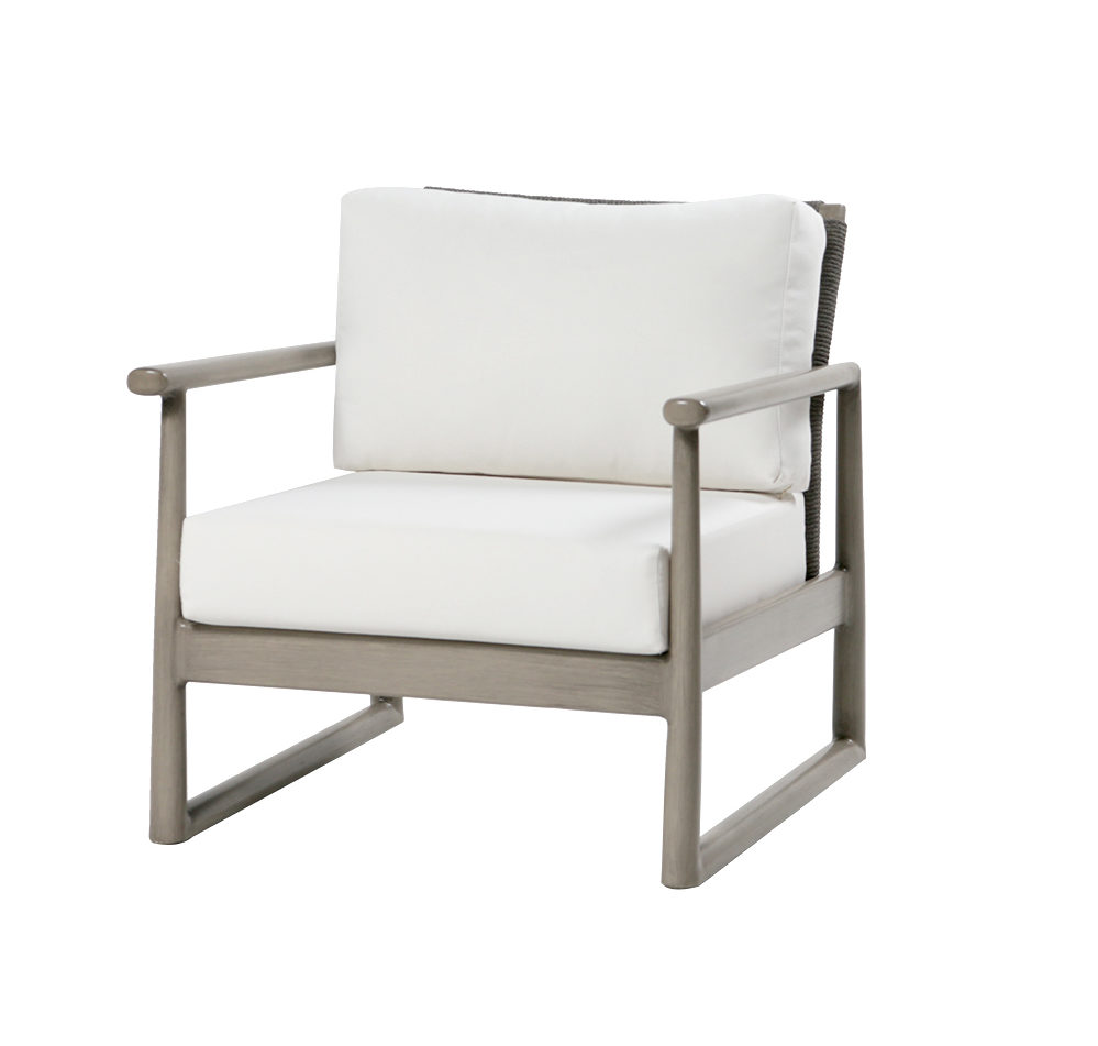 Park West Club Chair by Ratana with metal frame and light cushions.