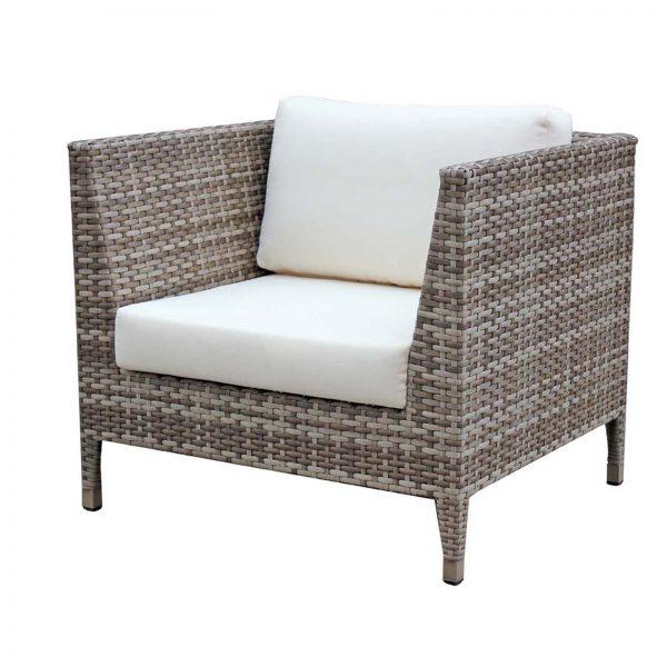 Ratana tuscany club chair with light brown wicker and cream cushions.