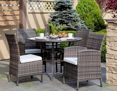 Coral Gables dining collection, featuring a round table, 4 chairs and green trees in background.
