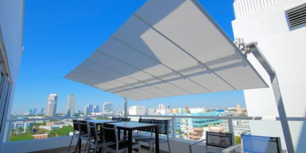 Fim Flexy shade system on patio with Miami in the background.