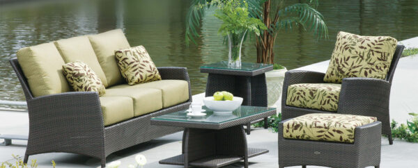 The Palm Harbor loveseat Ratana with matching sofa, club chairs, coffee tables and plants on a deck.