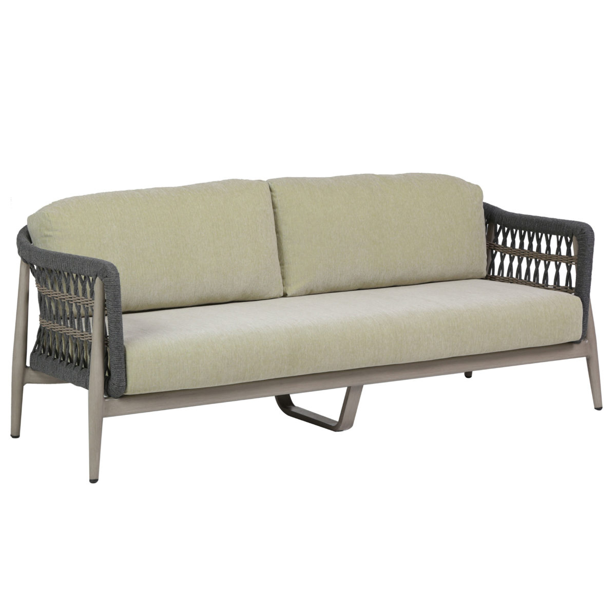 The Coconut Grove sofa Ratana in Aloe green cushions.