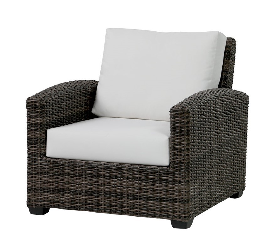 The Coral Gables club chair in brown wicker with light beige cushion.