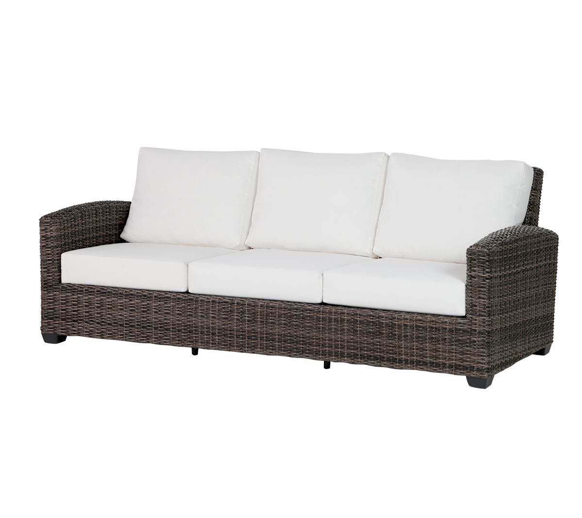 The Coral Gables sofa in brown wicker with cream colored cushions.