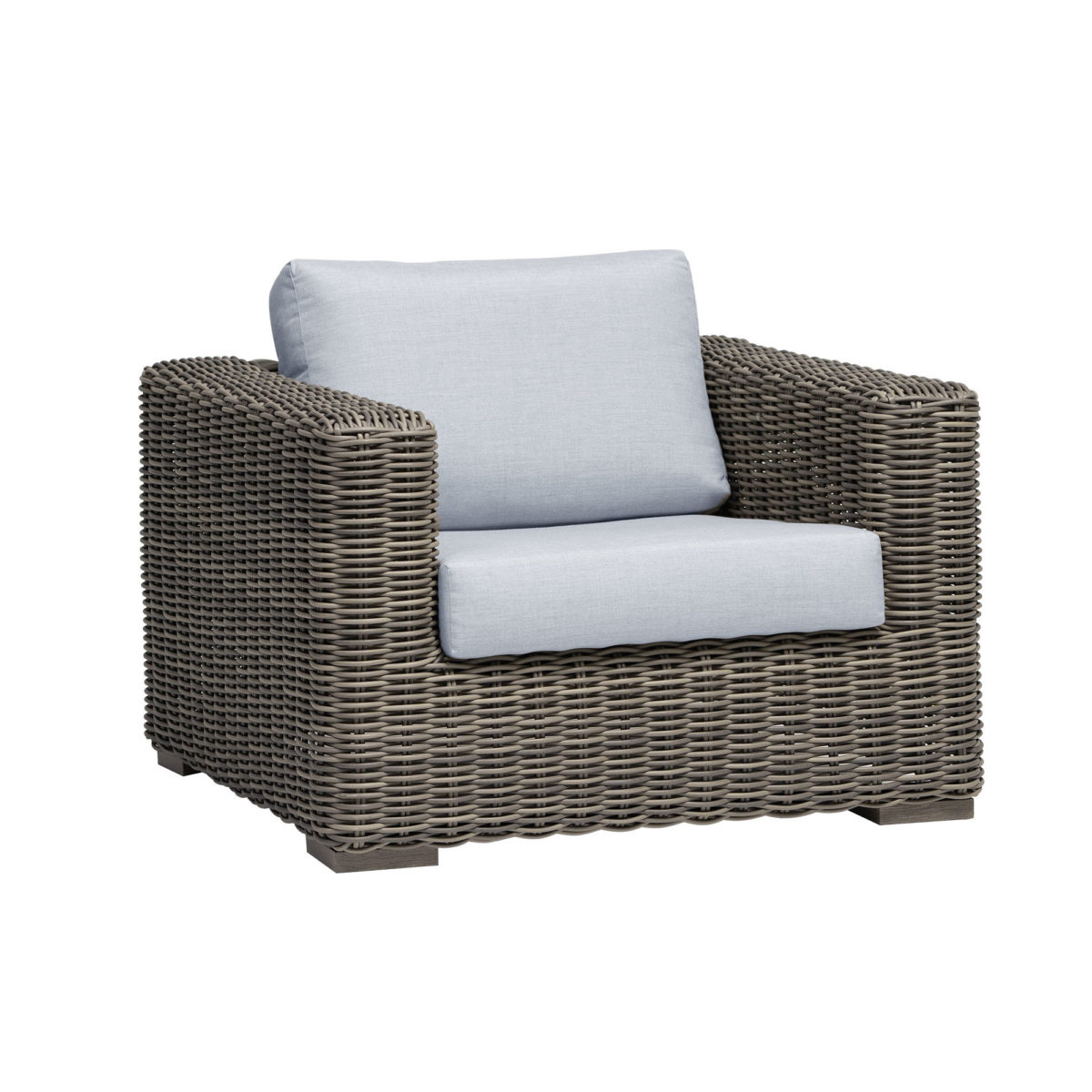 The Cubo club chair Ratana in cream oak wicker with grey cushions.