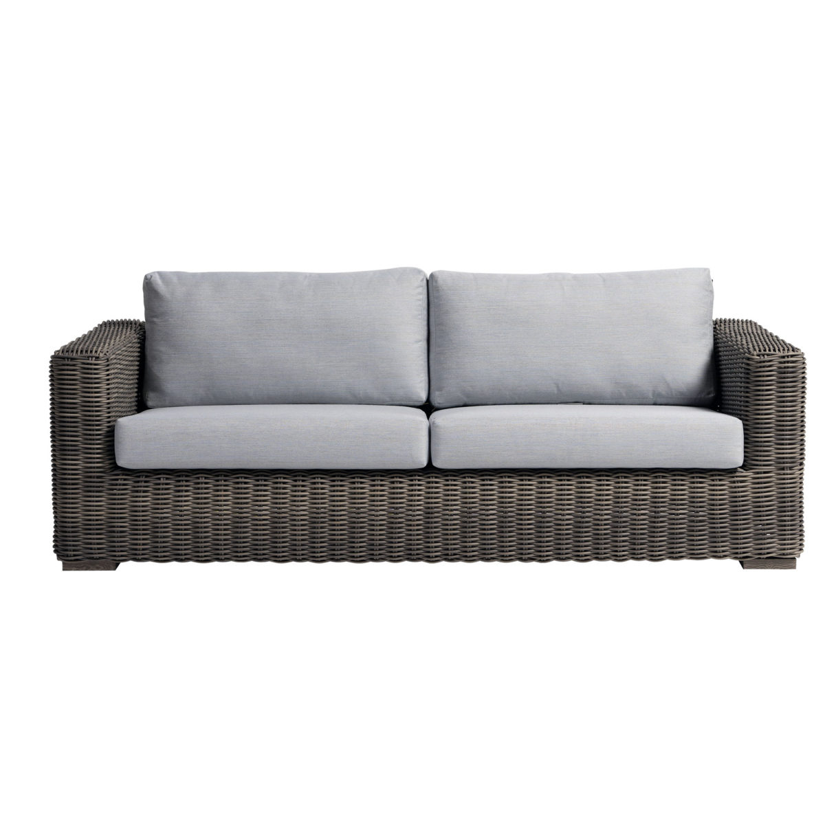 The Cubo sofa ratana in creamy oak wicker with taupe colored cushions.