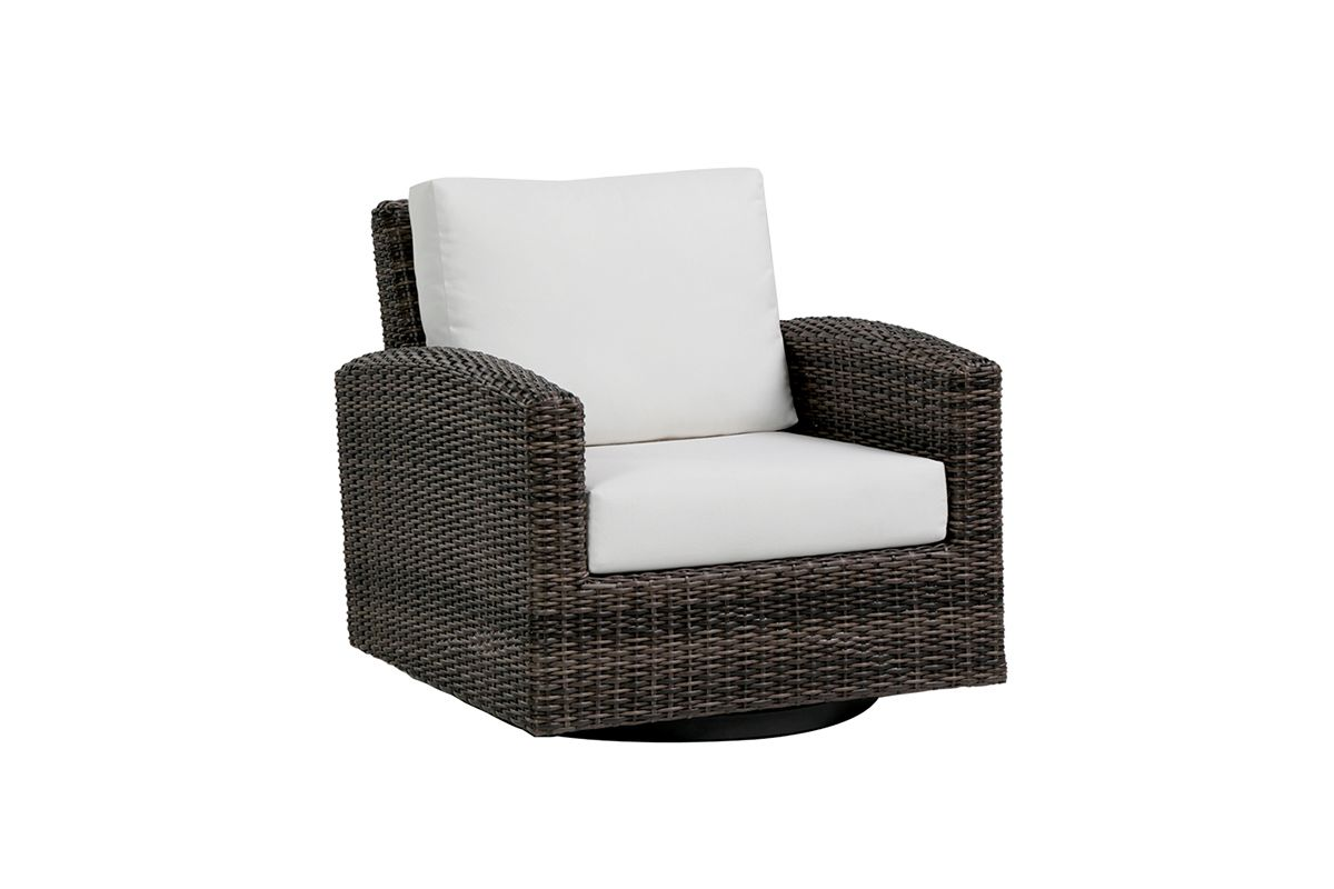 The Coral Gables swivel chair, shown in brown wicker with cream cushions.