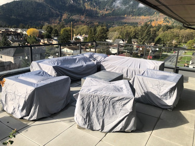 Patio club chair weather cover with mountains in background.
