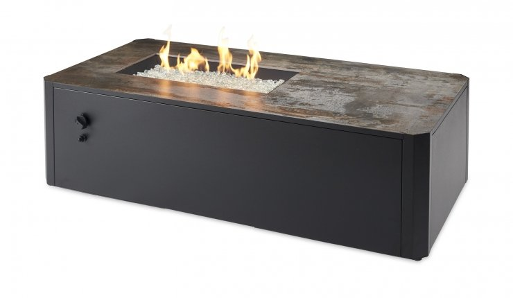 The Kinney linear fire table with flames on.