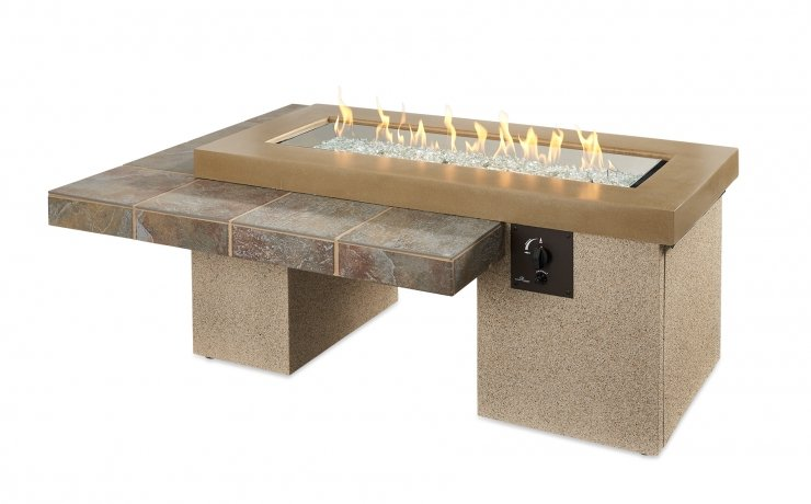 The brown Uptown fire table with flames on.