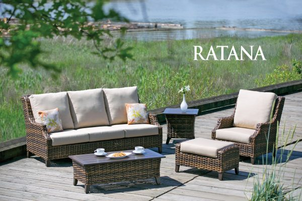 The Whidbey Island coffee table & club chair with ottoman on a deck with grass in background.