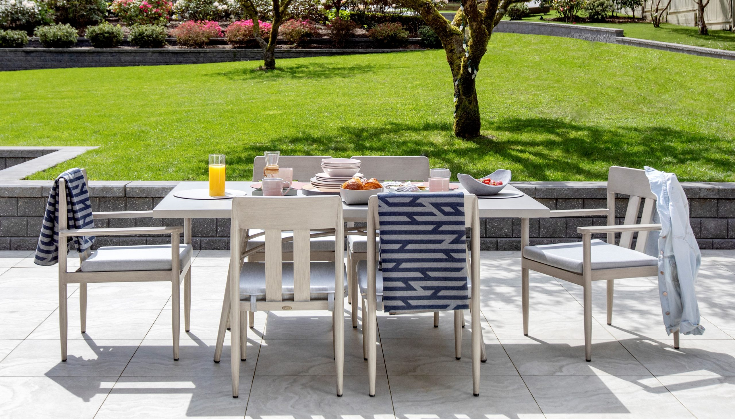 A dining set with 6 chairs show casing outdoor furniture Alberta.