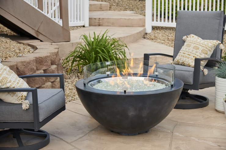 The Cove gas fire tables Toronto in black with the flame on and glass wind guard.